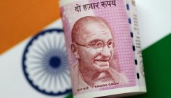 Rupee falls 34 paise to close at 75.95 against USD
