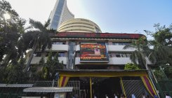 Sensex surrenders early gains, ends 63 points lower