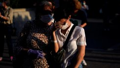 Spain revises virus death toll down by nearly 2,000