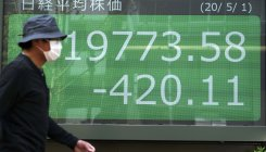 Nikkei pauses as profit-taking hits transport stocks