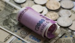 Rupee slips 8 paise to 75.74 against US dollar