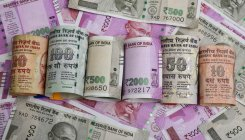 Rupee slips by 5 paise at Rs 75.71 against US dollar