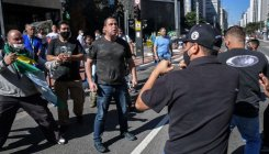 Bolsonaro tries to rein in backers amid protests