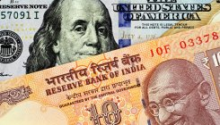 Rupee settles at 75.47 against USD over dollar buying