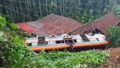 KSRTC bus falls on a house