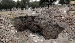 215 bodies found in Mexico mass graves