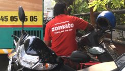 Zomato employees burn company T-shirts in protest