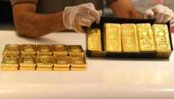 Gold eases as US data, vaccine hopes dent demand
