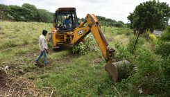 Covid-19: Earthmover used in Andhra to move dead body