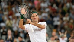 Federer missing Wimbledon, aiming to be back next year