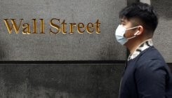 Coronavirus can't stop Wall Street, shares close higher