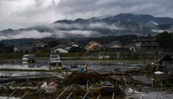 52 dead in Japan floods as more troops join rescue