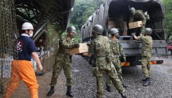 Japan rescuers battle to reach those trapped by floods