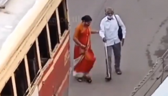 Young woman helps visually-impaired man boards bus