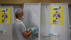 With gloves and masks on, Covid-19-hit Singapore votes