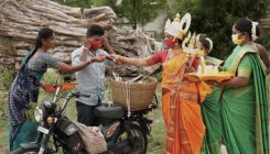 Woman dressed as goddess distributes masks in TN