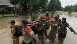 Flash floods kill 15 in Indonesia, dozens missing