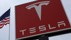 Tesla shares surge to record high