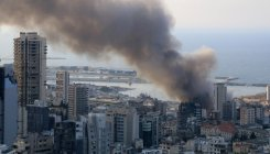 Lebanese firefighters douse remains of Beirut port fire