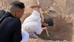 Iraqis dig up Covid-19 dead to rebury in family graves