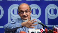 Bhushan pays fine, asks SC to review contempt order