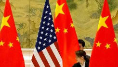 US eases China travel warning, citing Covid-19 progress
