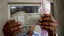 Rupee volatile against US dollar, ahead of Fed decision