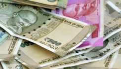 Rupee edges 12 paise higher at 73.52 against US dollar